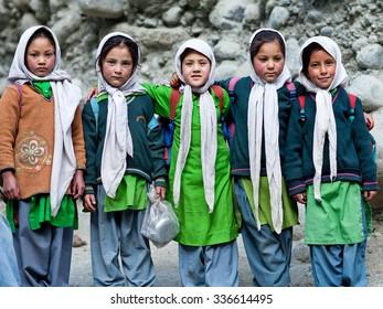 TURTUK, INDIA - JUNE 13: Balti students poses for a photo during their break time on June13, 2012 in Turtuk Village, Ladakh, India