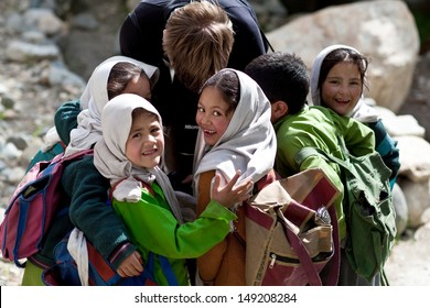 TURTUK, INDIA - JUNE 13: Group of Balti shoolgirls (Zuhra, 7, Aamina, 7, Fahrida, 7, Gulnaz, 7, and others) poses for a photo during her break time on June 13, 2012 in Turtuk Village, Ladakh, India.