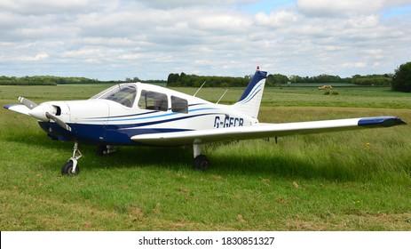 Turweston Aerodrome, Buckinghamshire, England / United Kingdom, 31 May 2019 : A Piper PA-28 Cadet training aircraft parked up