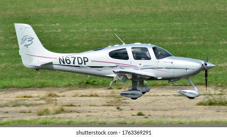 Turweston Aerodrome, Buckinghamshire/ United Kingdom - 30 August 2018 : A Cirrus SR22 light aircraft landing