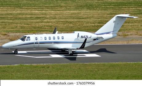 Turweston Aerodrome, Buckinghamshire/ United Kingdom - July 4 2018 : A Cessna 525 Citation CJ3 business jet equipped with Tamarack Winglets taking off