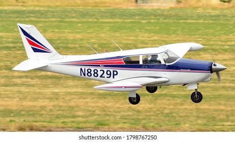 Turweston Aerodrome, Buckinghamshire/ United Kingdom - 4 July 2018 : A Piper PA-24 Comanche vintage light aircraft landing