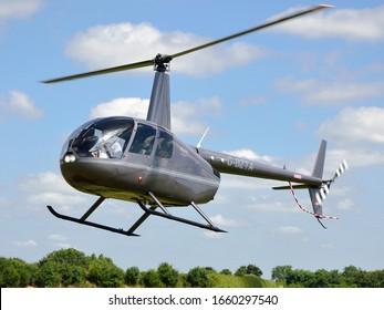 Turweston Aerodrome, Buckinghamshire/United Kingdom- June 22 2018: A Robinson R44 helicopter landing