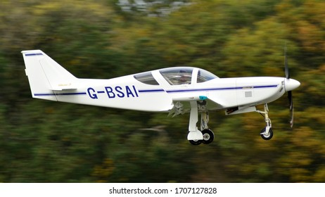 Turweston Aerodrome, Buckinghamshire/United Kingdom -October 18 2018 : A Glasair III homebuilt aircraft landing in front of blurred trees