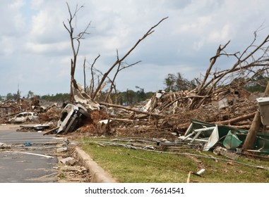 TUSCALOOSA, ALABAMA, U.S. - APRIL 2011: Mangled cars, trees and property in the aftermath of historic tornado that ravaged the southern United States on April 27, 2011 in Tuscaloosa, Alabama