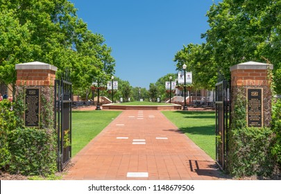 TUSCALOOSA, AL/USA - JUNE 6, 2018: Historical campus gates to the campus of University of Alabama.