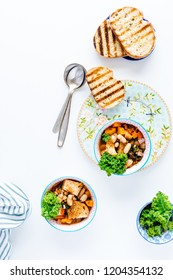 Tuscan Ribollita Soup - Ribollita meaning reboiled is a Tuscan soup made with bread and vegetables including leftover bread cannellini beans, carrot. kale and onion, garlic. Italian comfort food.