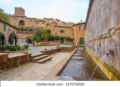 Tuscania, Italy - 2 December 2018 - A characteristic view in the historic center of this gorgeous etruscan and medieval town in province of Viterbo, Tuscia, Lazio region, touristic attraction.