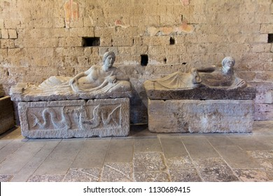 Tuscania, Italy - July 8, 2018: interior of San Pietro Church with etruscan sarcophagus