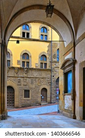 TUSCANY, AREZZO 25.04.2019. Columns and arches in old narrow street in historical centerof Arezzo with facade of medieval buildings. Italy