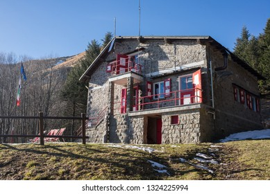 Tuscany, Italy - December 2018: Traditional Mountain hut built in stone at Porta Franca, Corno alle Scale, Apennine Mountains, Tuscany, Italy