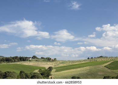 Tuscany, Italy landscape of farm and olive trees with clouds.