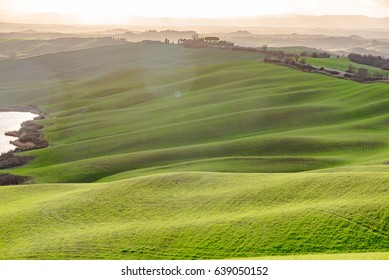 TUSCANY, ITALY - MARCH 25, 2017 - Misty valleys in central Tuscany with farms in the province of Siena