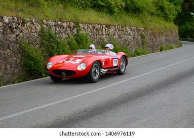 Tuscany, Italy - May 2019: unidentified drivers on MASERATI 150 S 1955 during public event of historical parade of the Mille Miglia near Monteriggioni. Italy.