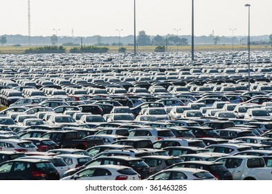 Tuscany - JUNE 27, 2012: New cars parked at distribution center