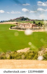 Tuscany landscape with country mansion on the hill