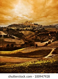 Tuscany landscape, dramatic Sunset with San Gimignano in the background