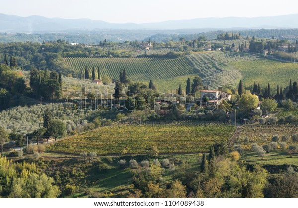 Tuscany landscape with fields and mountains in background