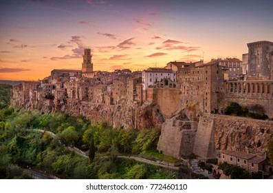 Tuscany, Pitigliano medieval village on tuff rocky hill. Panorama sunset. Italy, Europe.