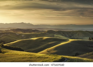 Tuscany spring, rolling hills on sunset. Rural landscape. Green fields and farmlands. Volterra Italy, Europe