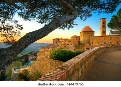 Tuscany, Volterra town skyline, church and trees on sunset. Maremma, Italy, Europe