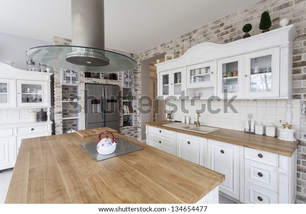 Tuscany - white kitchen shelves and silver refrigerator