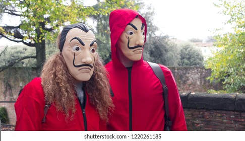 """Tuscany/Italy - 11-03-2018: Cosplay of Money Heist (""""La Casa de Papel"""" in Spanish) at Lucca Comics & Games festival (the largest comic book and gaming convention in Europe)"""
