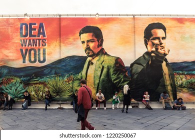 """Tuscany/Italy - 11-03-2018: """"Narcos Mexico"""" huge promotional poster at the Netflix stand at Lucca Comics & Games festival (the largest comic book and gaming convention in Europe)"""