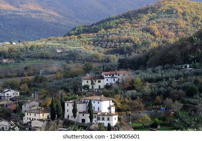 Tuscany,italy, December 2018, landscape of the counytryside near Arezzo with a village, hills and mountains in autumn colors