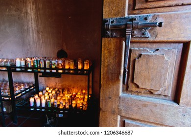 Tuscon, Arizona/USA - February 2, 2016: Mission San Xavier del Bac open door and prayer candles