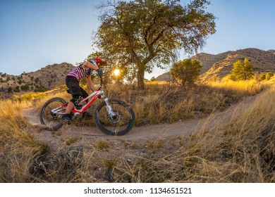 TUSCON, USA - MAY 22, 2012: downhill rider Simon Seeholzer at training on the trail in Tuscon, USA. There are yearly around 1000 bicycle related deaths in the US, 75 % due to head injuries.