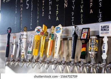 Tustin, California/United States - 11/03/2019: Several beer brand tap handles at Drink Bar located at Mess Hall at Flight.