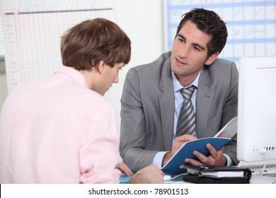 Tutor advising his student