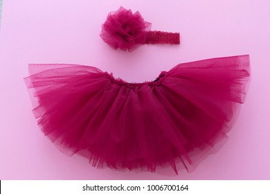 Tutu pink, purple, skirt with flower headband for newborn girl. Concept of children's clothing.