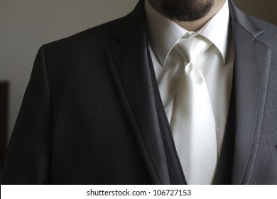 Tuxedo / Standing groom in a gray tuxedo. Image was taking during a wedding.