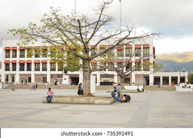Tuxtla Gutierrez, Mexico - January 15, 2015: People stroll the huge main square of the modern city of Tuxtla Gutierrez, the capital of Chiapas State. Tuxtla City hall is seen in the background