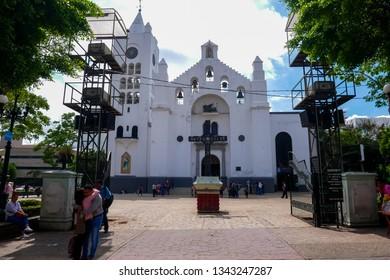 Tuxtla Gutiérrez, Mexico - August 1, 2018 : Couple Hugging in front of St Mark's Metropolitan Cathedral (Catedral Metropolitana de San Marcos), Tuxtla Gutiérrez, Mexico