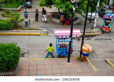 Tuxtla Gutiérrez, Mexico - July 29, 2018 : Locals buying juices in small market stall at Marimba Park, Tuxtla Gutierrez