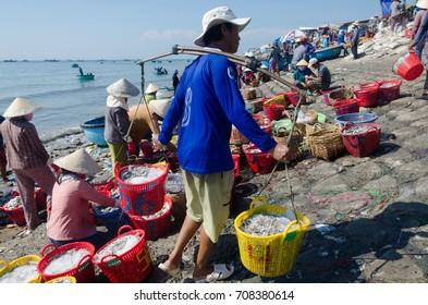TUY PHONG, VIETNAM - AUG 14TH, 2017: many fishermen are working at Phuoc The village, Tuy Phong, Binh Thuan, Vietnam