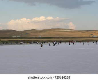 TUZ GOLU,AKSARAY,TURKEY-JULY 22:Unidentified people walking on Salt lake.July 22,2017 at Tuz Golu in Aksaray,Turkey.