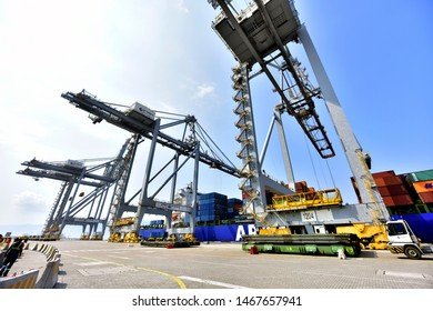 Tuzla shipyard and harbor. Tanker and winches, Istanbul, Turkey, July 2019; Logistics and Container Cargo ship and working crane bridge in shipyard