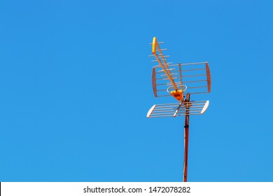 TV antenna with a blue sky background