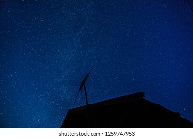 TV antenna with building at night