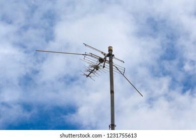 TV antenna on blue sky background