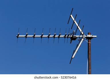 TV antenna for receiving terrestrial television UHF band against the blue sky.