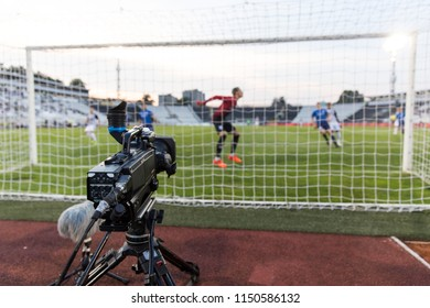 TV camera behind the football goal at the stadium during football matches