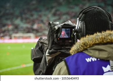 TV camera during football match.