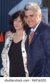 TV chat show host JAY LENO & wife MAVIS at charity event at Santa Monica Airport for The Robb Report's Best of the Best: Los Angeles. August 28, 2004