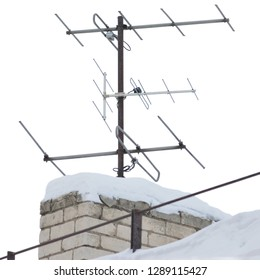 TV and communication aerials on snowy roof of residential house, multiple isolated dvb-t antennas winter scene, large detailed vertical closeup, rusty grunge vintage set