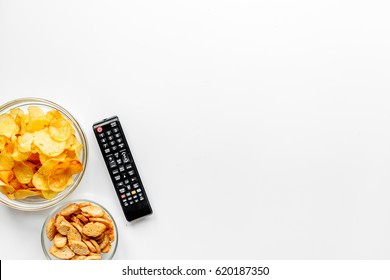 TV control and snacks on white background top view space for text